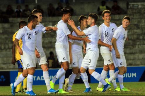 New Zealand celebrate Noah Billingsley's crucial strike ©New Zealand Football