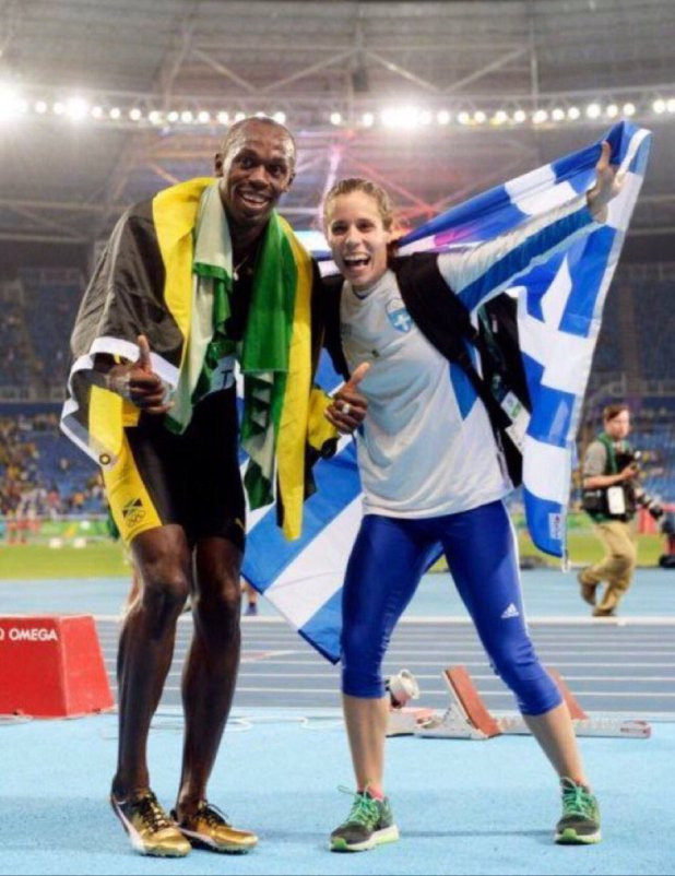 Greece's Katerina Stefanidi celebrates winning the Olympic gold medal in the pole vault at Rio 2016 with Usain Bolt after he had helped Jamaica race to victory in the 4x100 metres relay ©Twitter