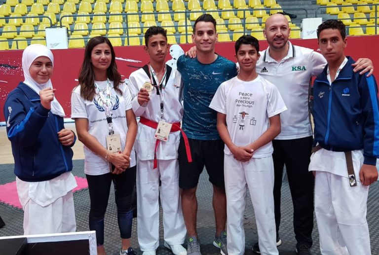 Jordan's Olympic gold medallist Ahmad Abughaush, centre, has backed the Azraq project ©THF