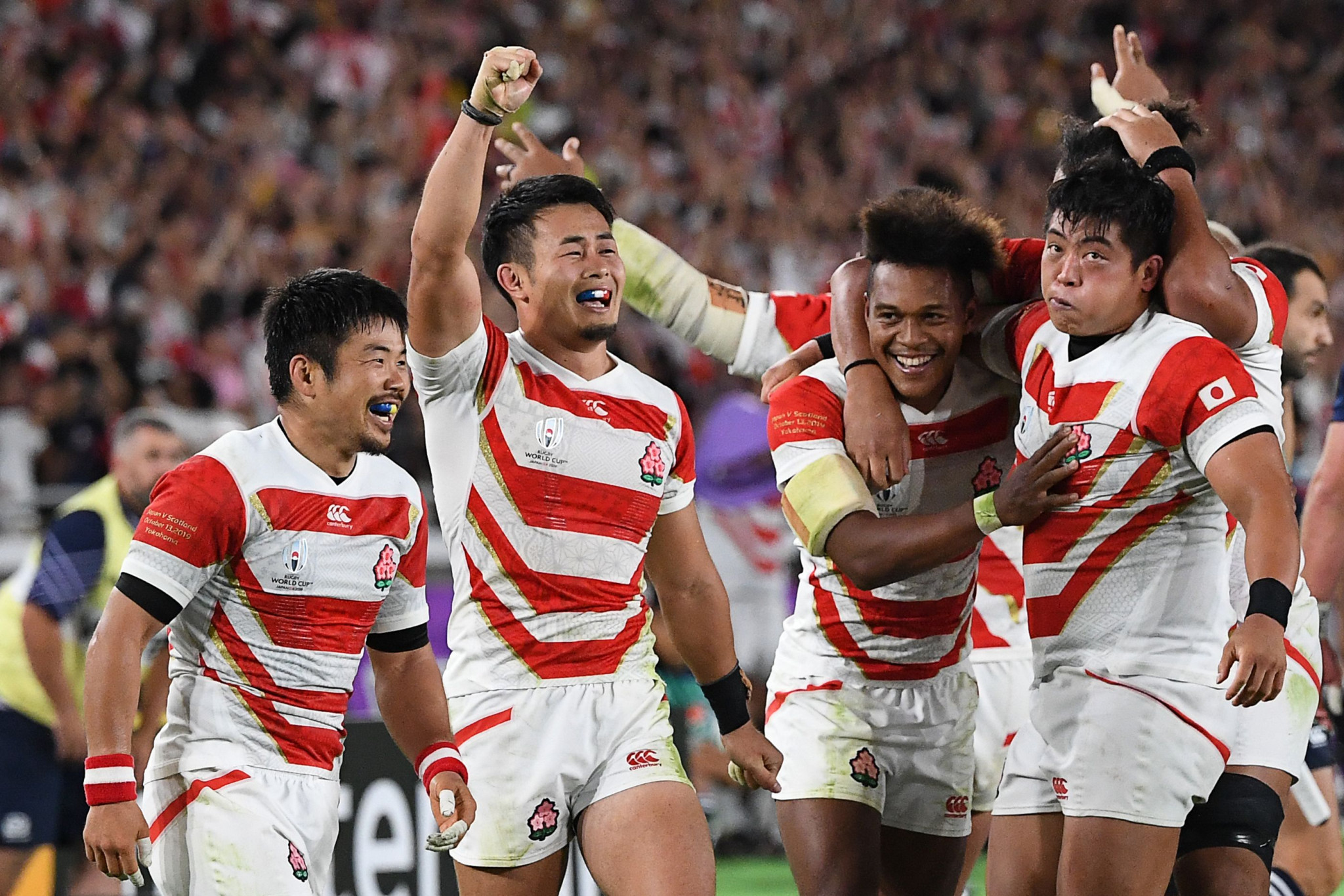 Japanese players celebrate their 28-21 victory against Scotland ©Getty Images