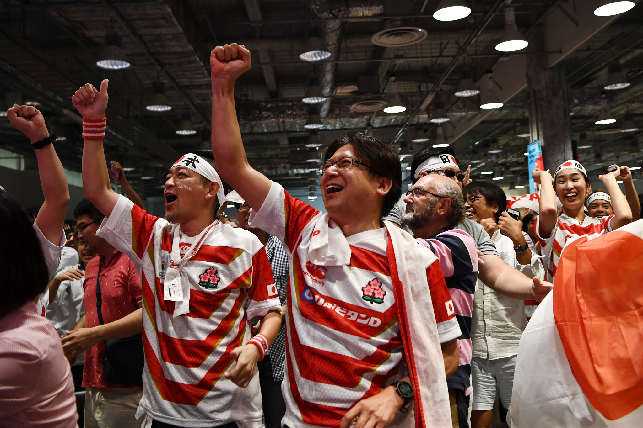 Fans in Yokohama were all smiles as Japan booked their place in the Rugby World Cup quarter-finals ©Getty Images