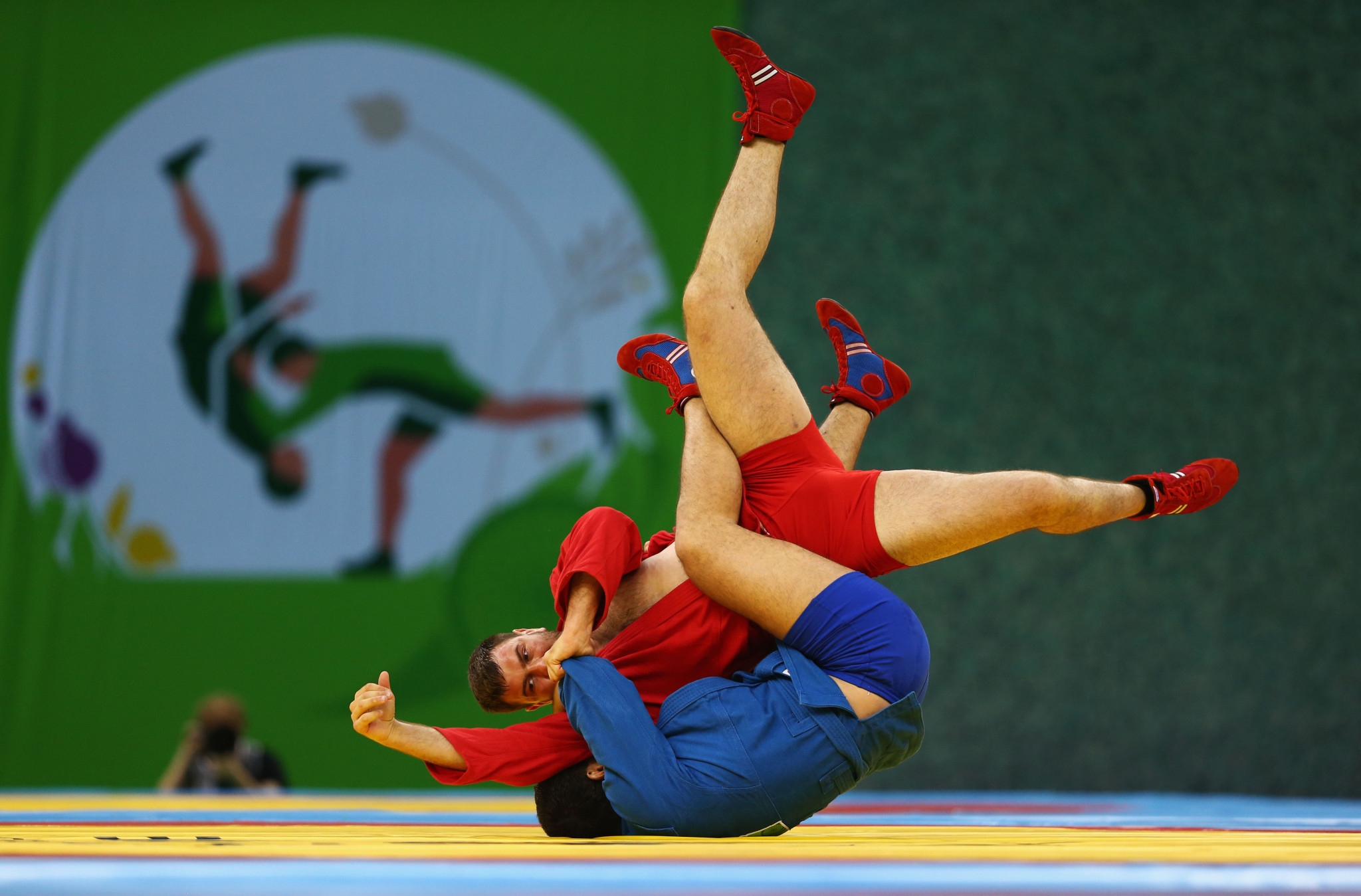Artem Osipenko of Russia, in blue, will seek an eighth world title at the World Sambo Championships in Cheongju ©Getty Images