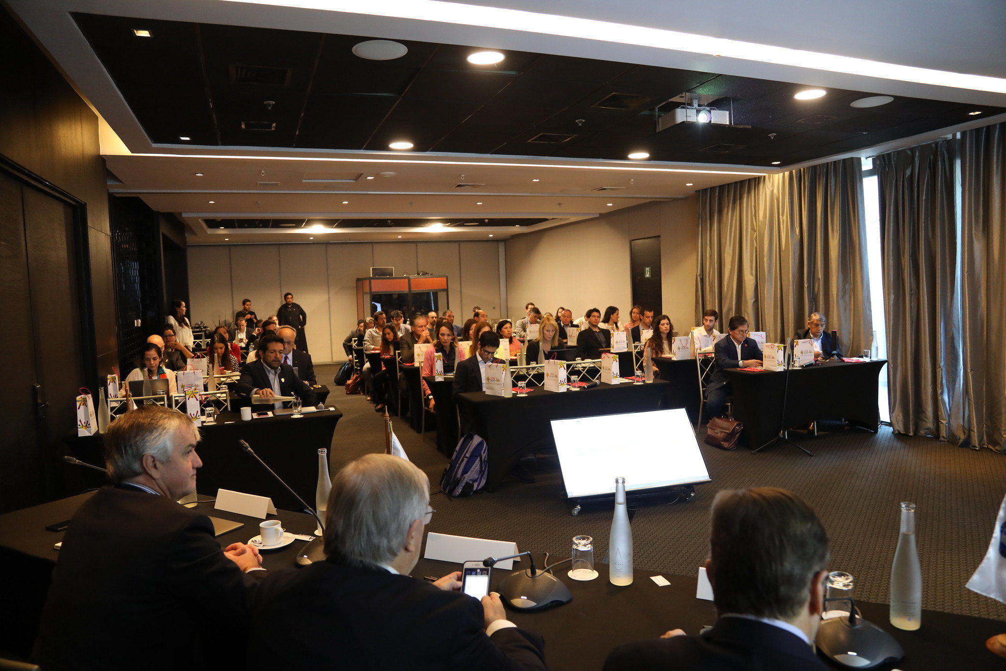 Lima 2019 and Santiago 2023 officials discussed areas including infrastructure, volunteering and budgets during a seminar in Santiago ©Panam Sports