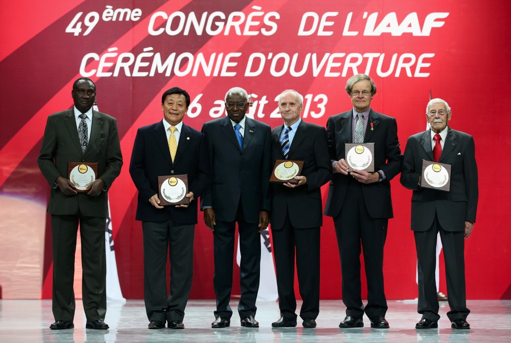 Isaiah Kiplagat (left) pictured with other IAAF officials including former President Lamine Diack (centre) during the 2013 World Championships in Moscow ©Getty Images