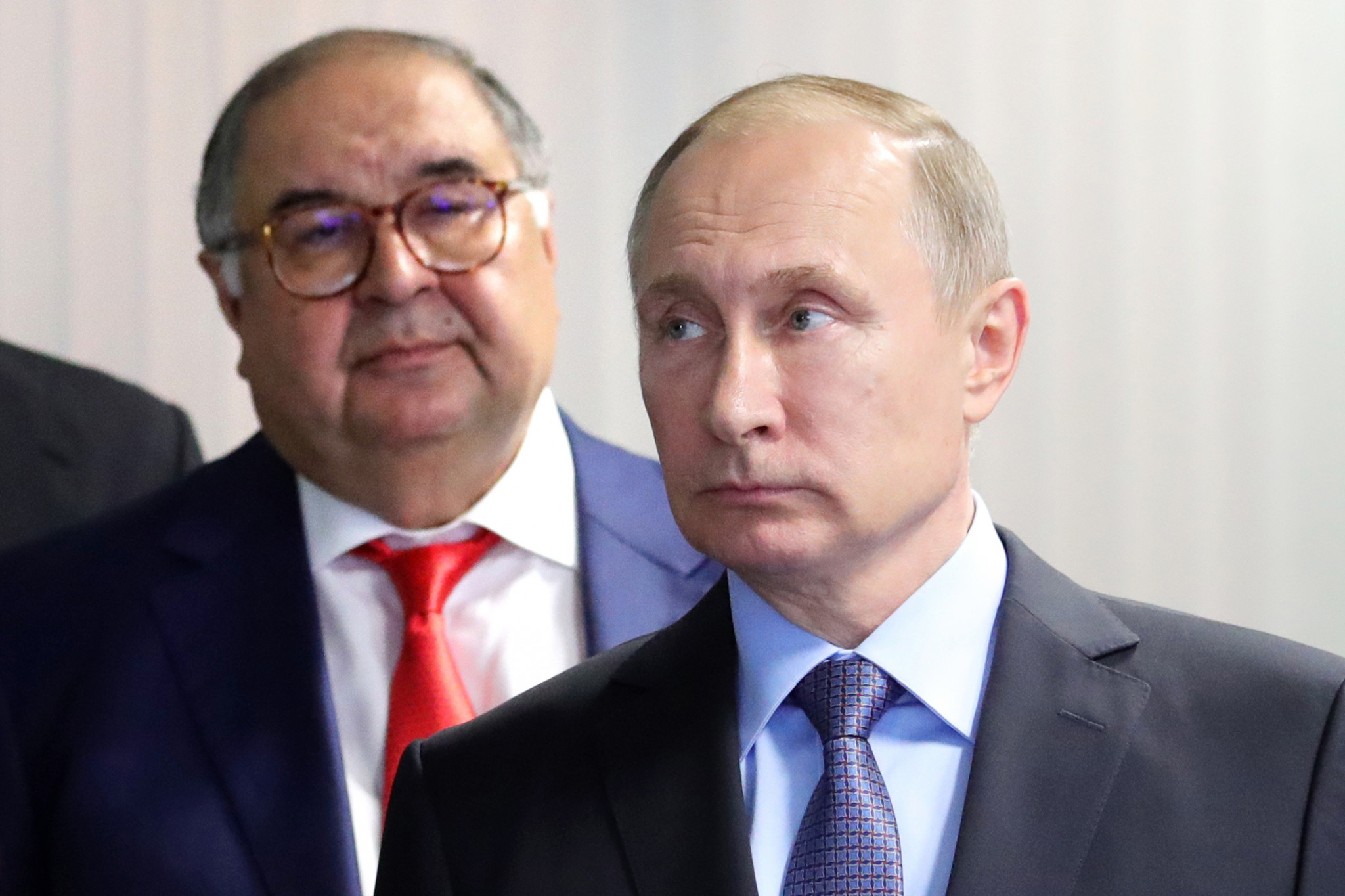 Alisher Usmanov, left, is known to be close to Russian President Vladimir Putin ©Getty Images