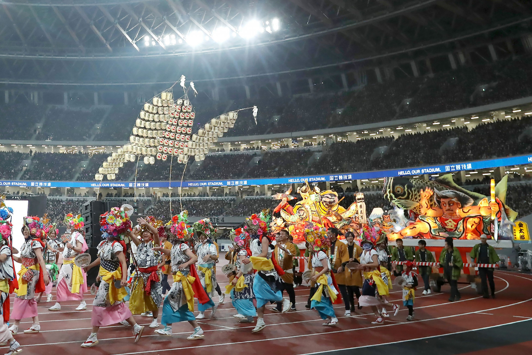 Small ceremony and unique relay featuring Usain Bolt help to open Tokyo 2020 Olympic Stadium