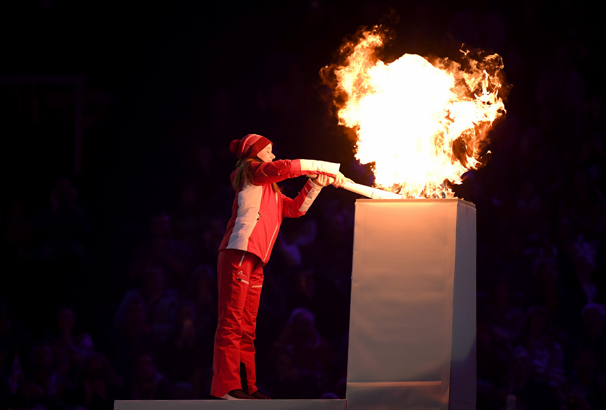 The flame was lit by Gina Zehnder, the youngest member of the Swiss team ©Getty Images