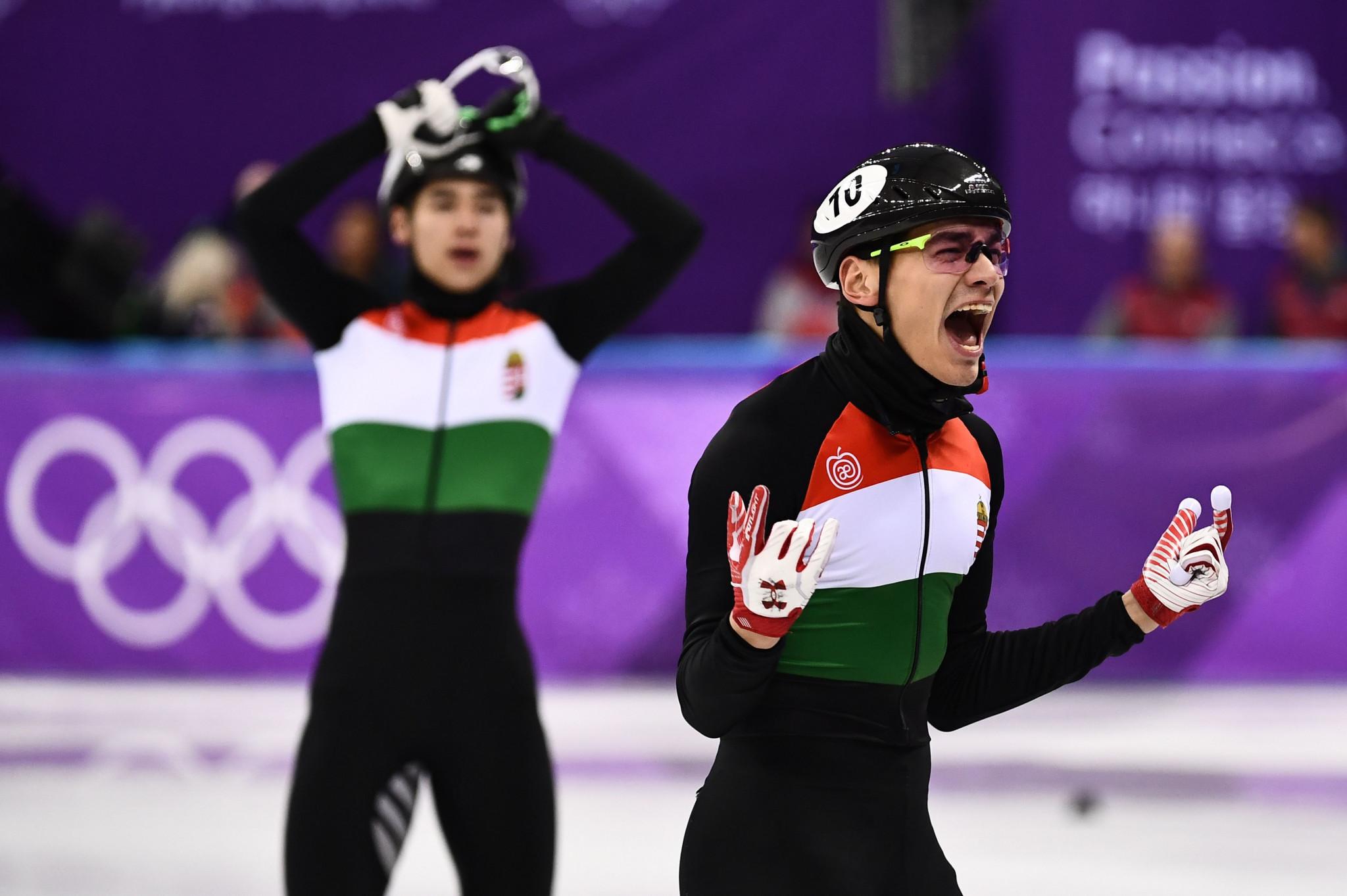 Shaolin Sandor and Shaoang Liu celebrate winning the 5,000m relay at Pyeongchang 2018 Winter Olympics © Getty Images