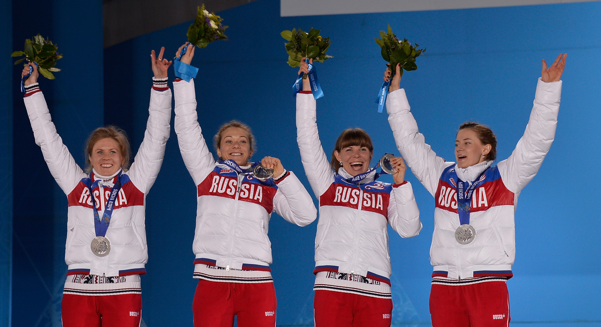 Russia's Olga Vilukhina, pictured right celebrating a biathlon relay silver at the Sochi 2014 Games that was subsequently annulled for doping, will attend her delayed CAS appeal on March 2 and 3 ©Getty Images