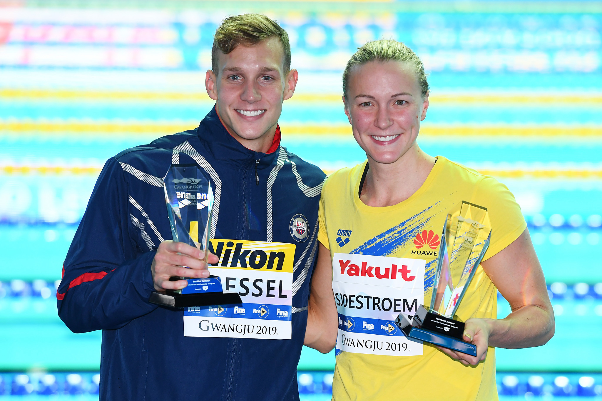 Caeleb Dressel and Sarah Sjostrom, pictured last year with their trophies, retained them in swimming categories ©Getty Images