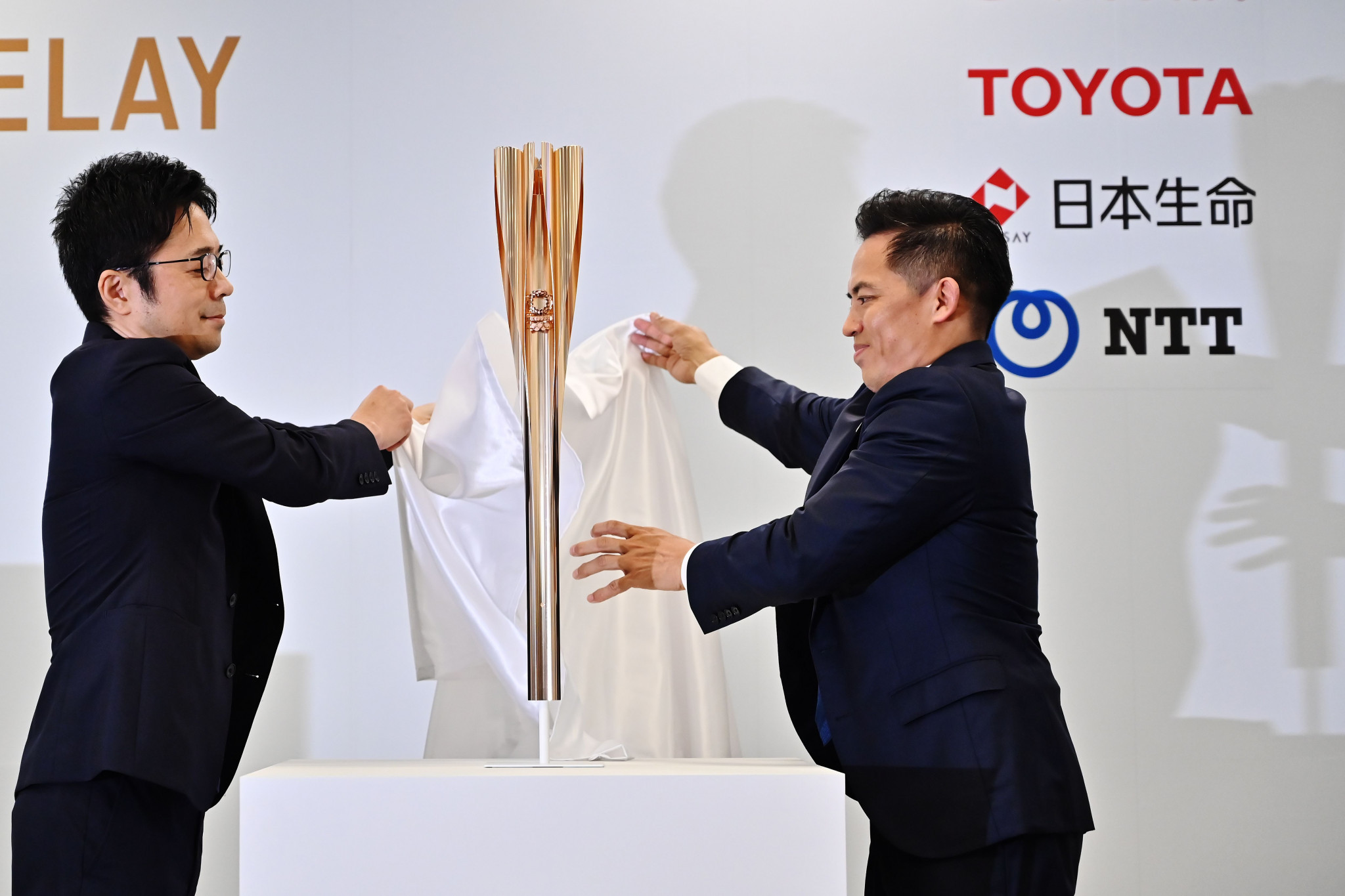 Tokujin Yoshioka, left, helped unveil the design of the Tokyo 2020 Olympic Torch in March 2019 ©Getty Images