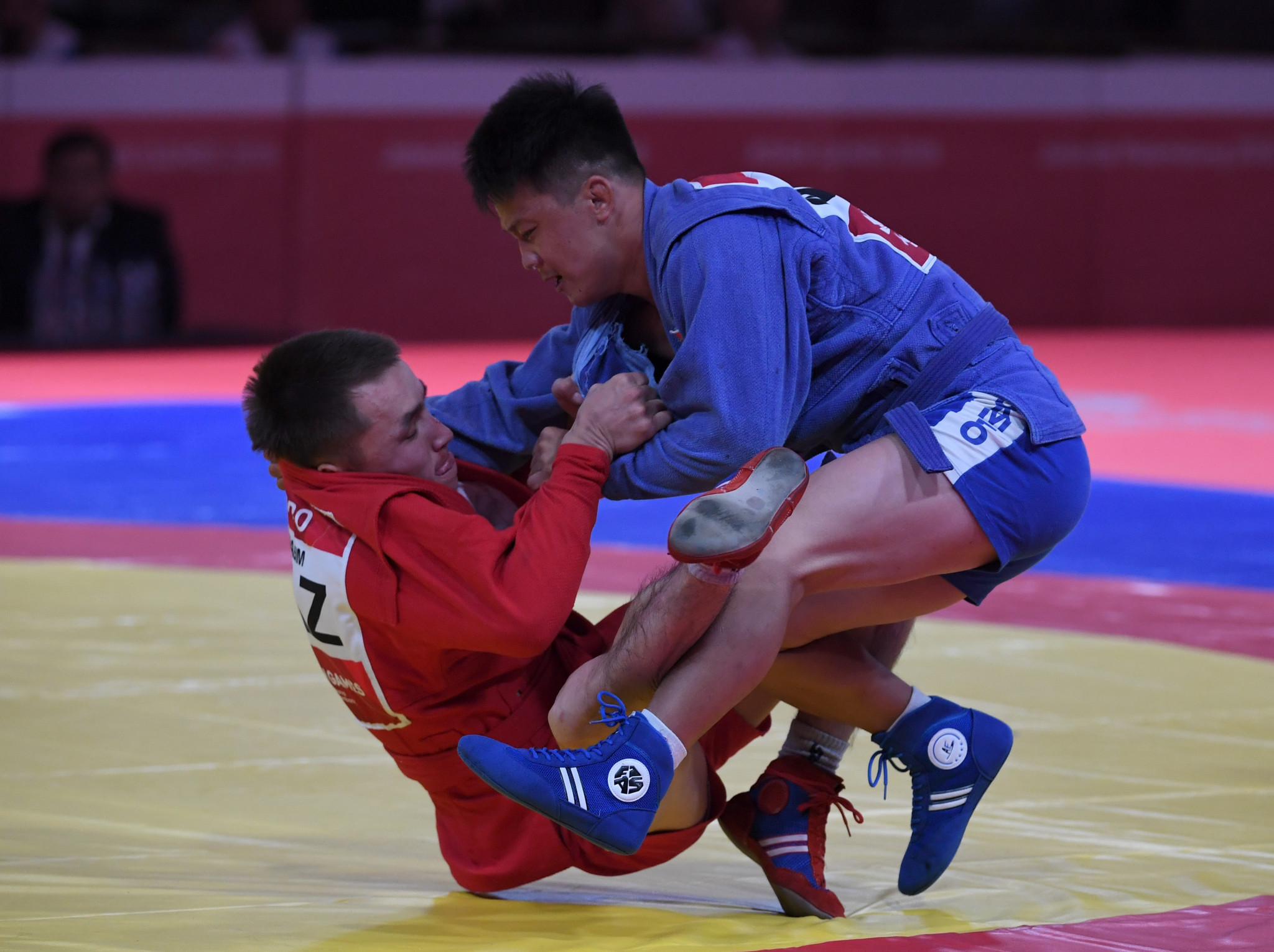 Kazakhstan's Baglan Ibragim fights Mongolia's Erdenebaatar Shaaluu during the final of the men's - 52kg Sambo event at the 2018 Asian Games in Jakarta on August 31, 2018. © PUNIT PARANJPE/AFP via Getty Images