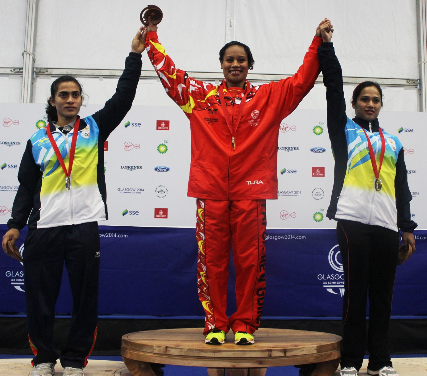 Celebrating a gold medal at Glasgow 2014 ©Oceania Weightlifting Institute