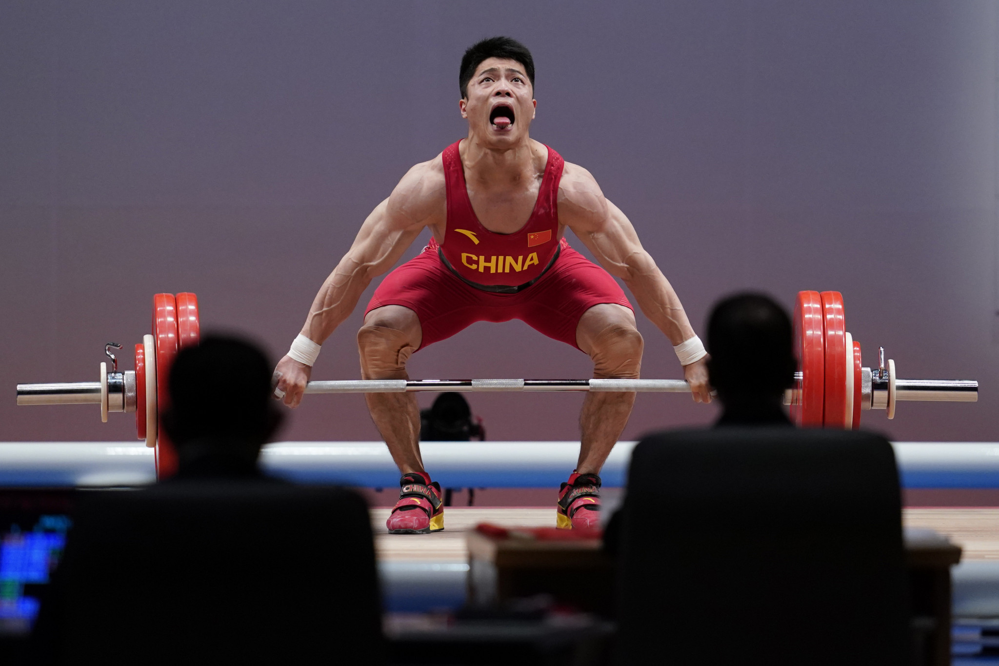 China's weightlifters power on towards Olympic glory