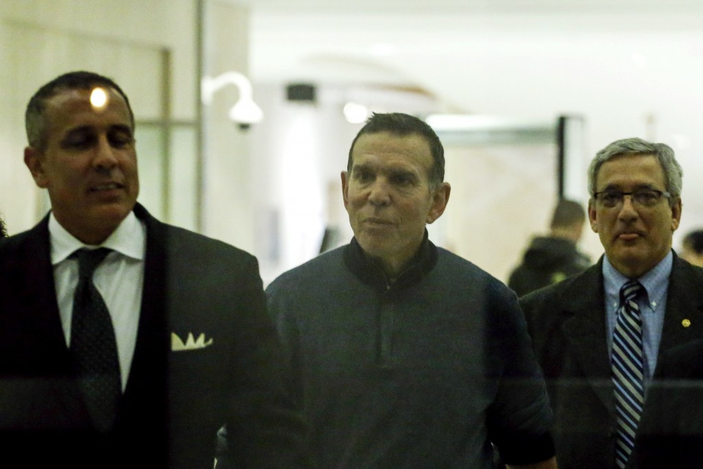Juan Angel Napout, centre, after pleading not guilty to bribery at the Federal District Court in Brooklyn  ©Getty Images