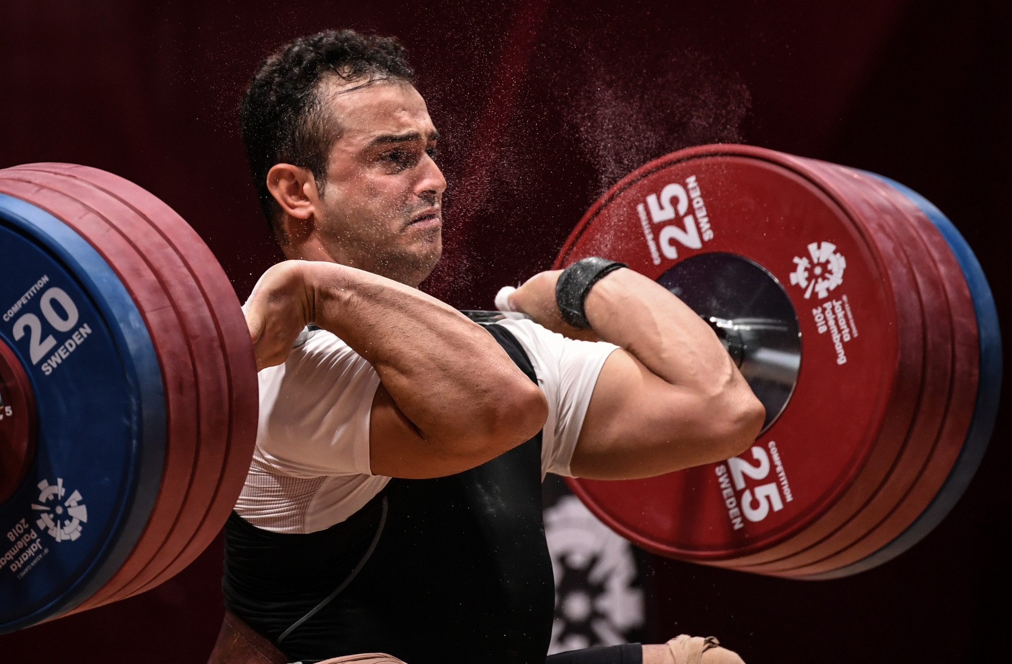 Iranian Sohrab Moradi is among the weightlifters who may benefit from the new qualification process  ©Getty Images
