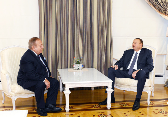 Azerbaijan President Ilham Aliyev, right, receives Tamás Aján in 2016, with the image published by Azerbaijan's state-run news agency ©AZERTAC