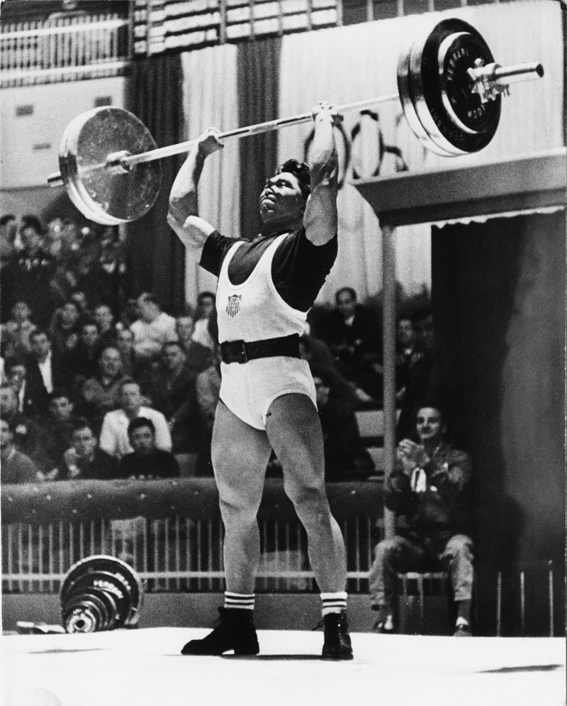 American weightlifter Tommy Kono in action during the Middleweight Class Event at the 1960 Summer Olympics. Kono also won Gold in the 1956 Olympic Games. © Central Press/Hulton Archive/Getty Images.