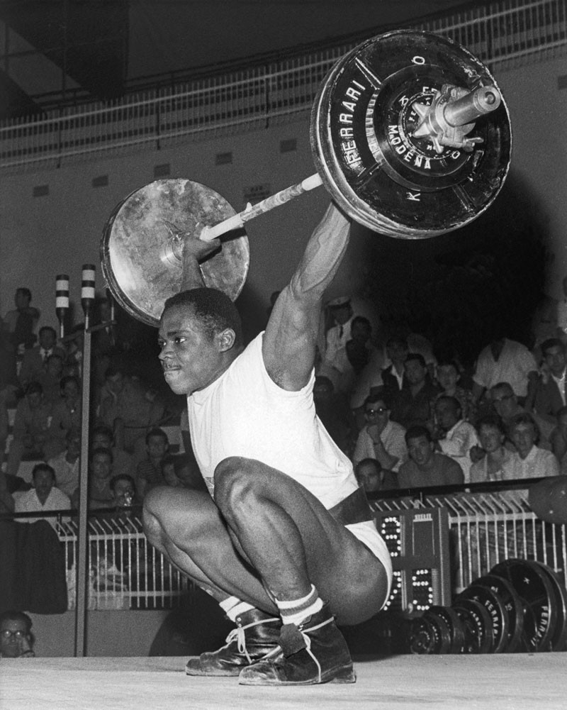 British weightlifter Louis Martin competing in the Middle Heavyweight event at the Rome Olympics, 12th September 1960. Martin eventually won the bronze medal. © Central Press/Hulton Archive/Getty Images.