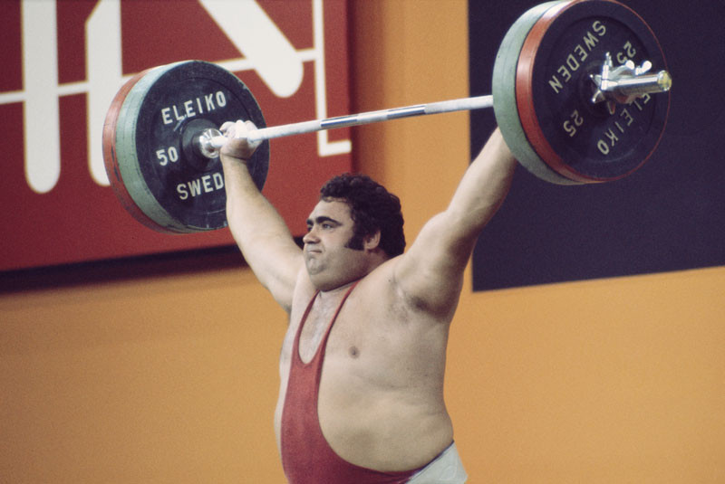 Vasily Alexeyev of the Soviet Union successfully lifts the bar bell above his head during the Super- Heavyweight Weightlifting event at the 1976 Olympic Games in Montreal, Canada. Alexeyev won the gold medal with a lift of 440 kilograms. © Allsport UK /Allsport