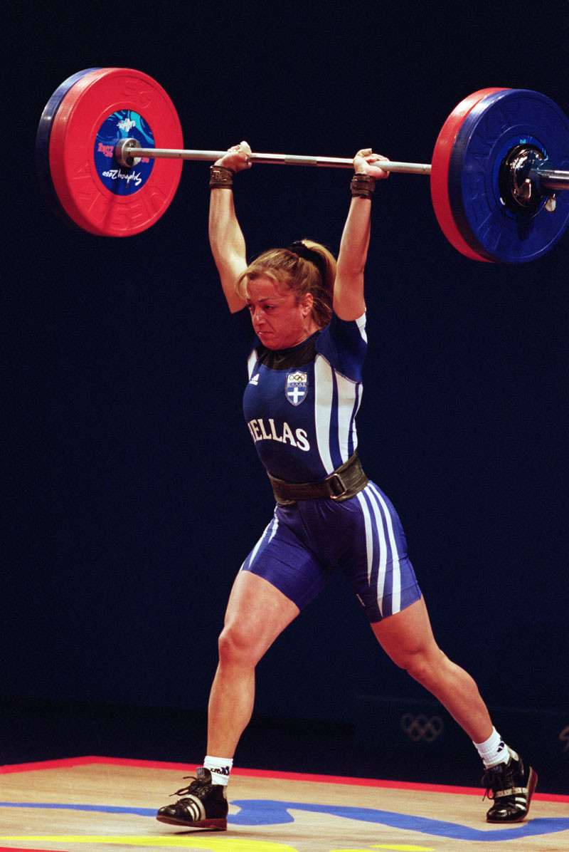 Ioanna Chatziioannou of Greece in action during the Women's 63Kg Weightlifting event of the 2000 Sydney Olympic games held in the Sydney Convention Center on the 23rd September 2000. © Adam Pretty/Getty Images.