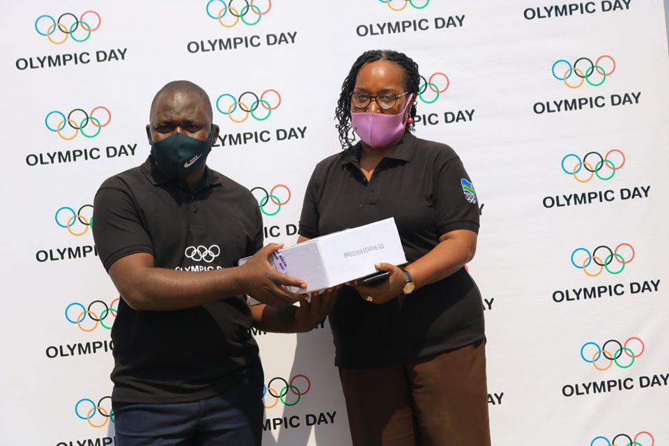 Rwanda NOC donates hand sanitiser to 700 taxi-moto riders