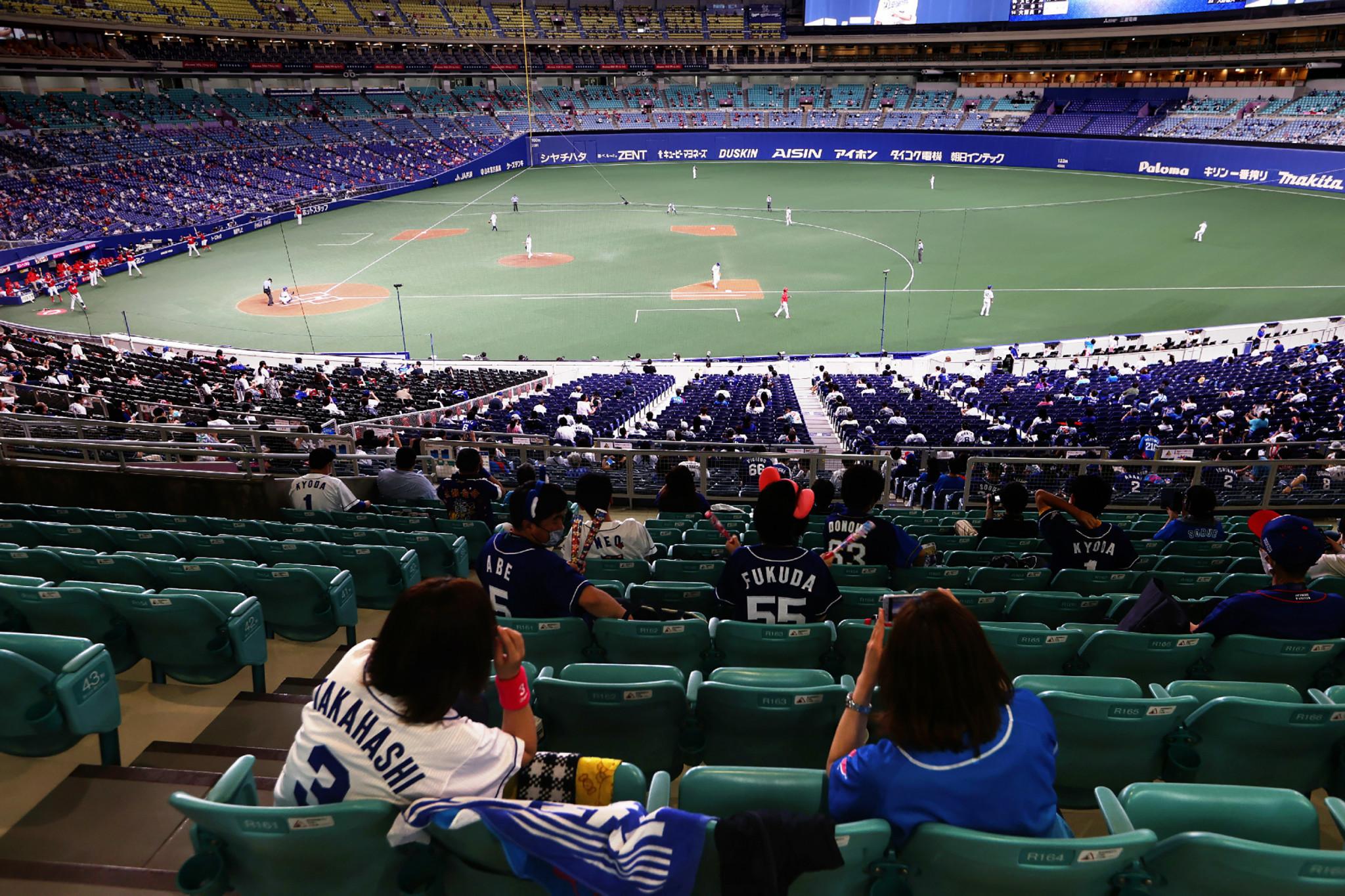 Fans return to stadiums in Japan under precautions as coronavirus cases rise