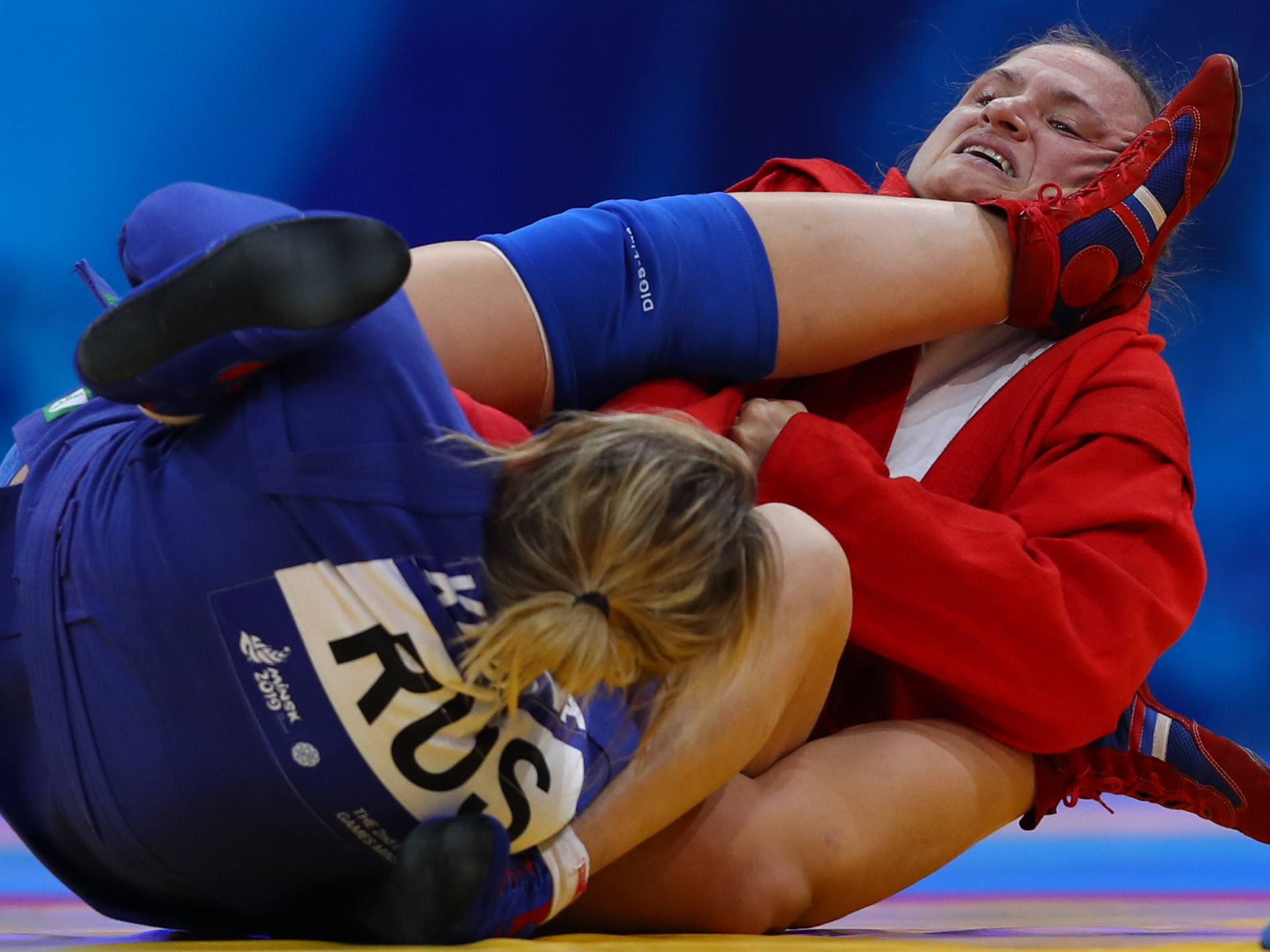 Mariya Oryashkova of Bulgaria (red) competes against Zhanara Kusanova of Russia (blue) in the Women's 80kg Sambo Gold Medal match Final during day two of the 2nd European Games at Sports Palace on June 23, 2019 in Minsk, Belarus.  © Francois Nel/Getty Images.