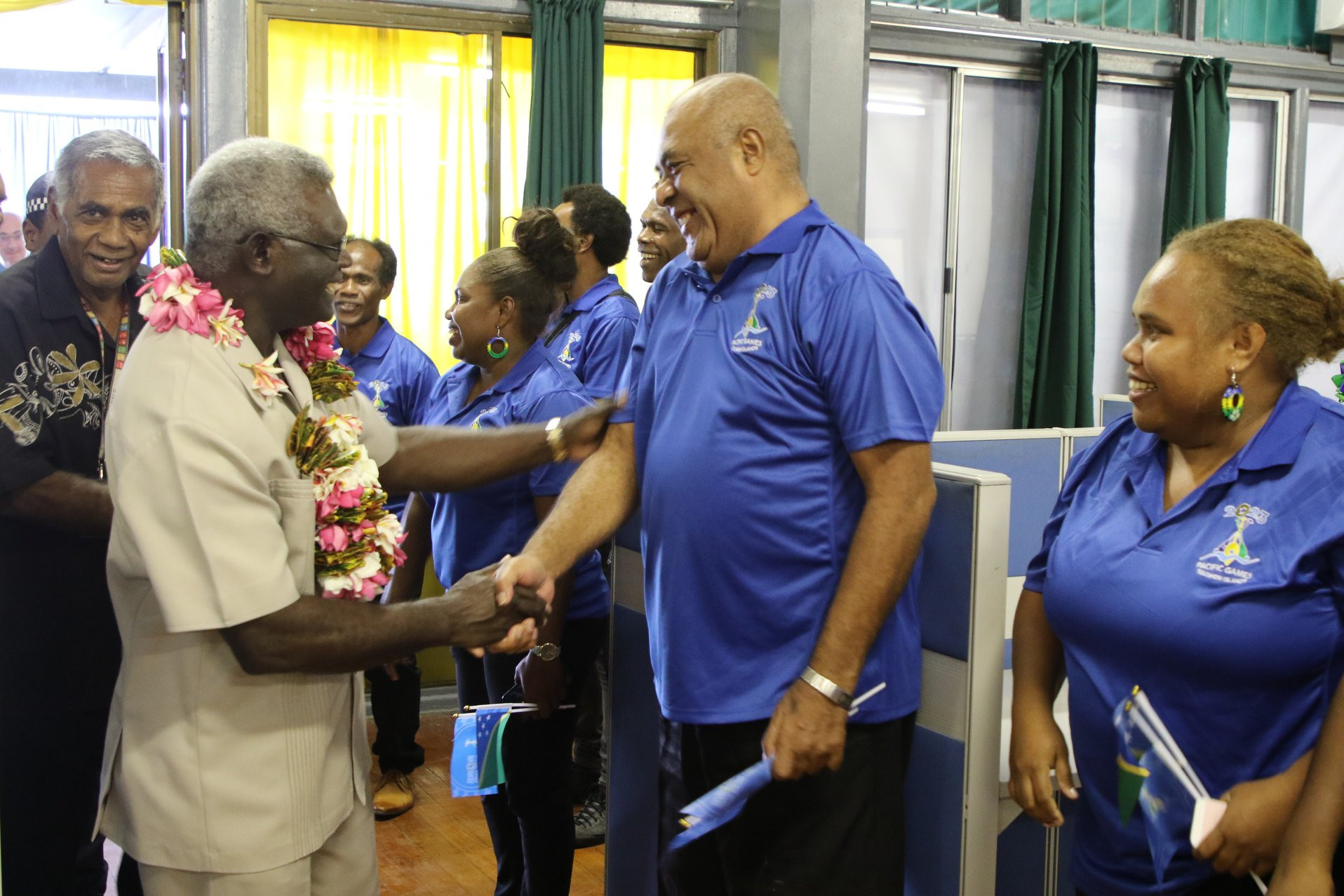 Workers at the new Solomon Islands 2023 offices greet the country's Prime Minister Manasseh Sogavare at the opening ©Solomon Islands Government