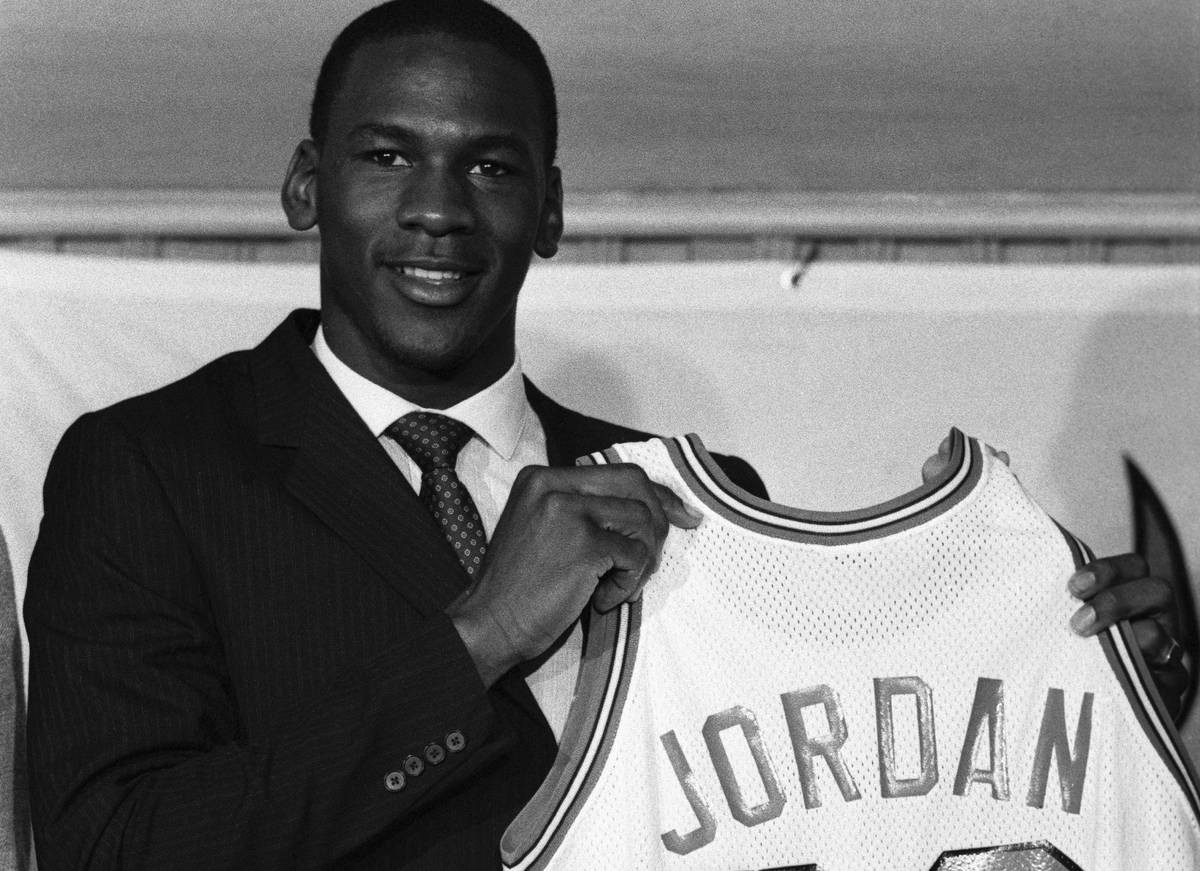 Michael Jordan shows off his first NBA shirt from his 1984 season ©Getty Images