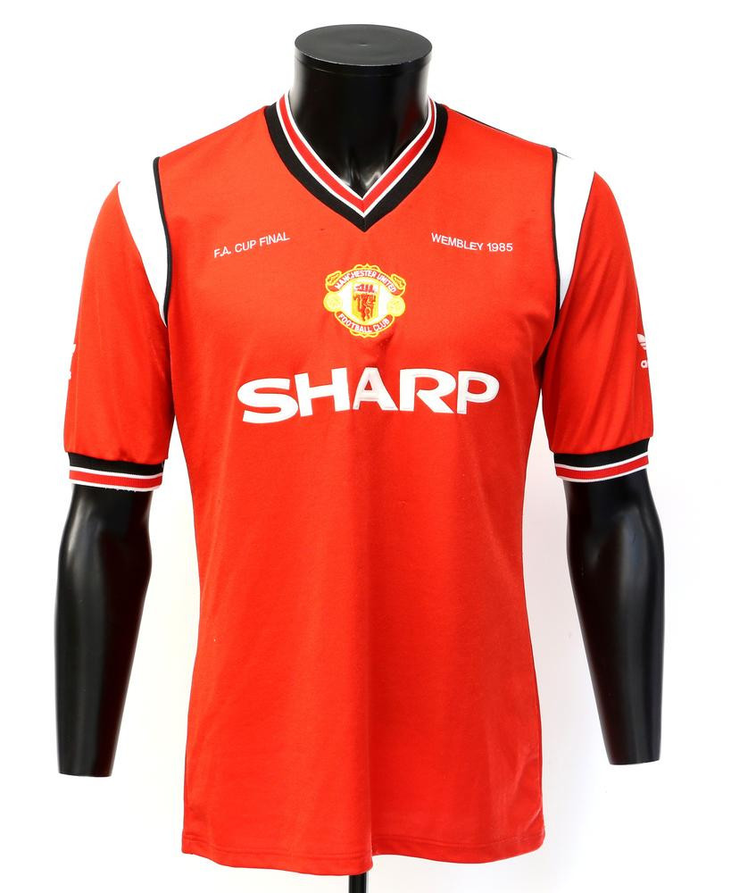 The shirt that Norman Whiteside was wearing when he scored the winning goal in Manchester United's FA Cup final victory over Everton in 1985 raised £23,000 ©Ewbank's Auctions