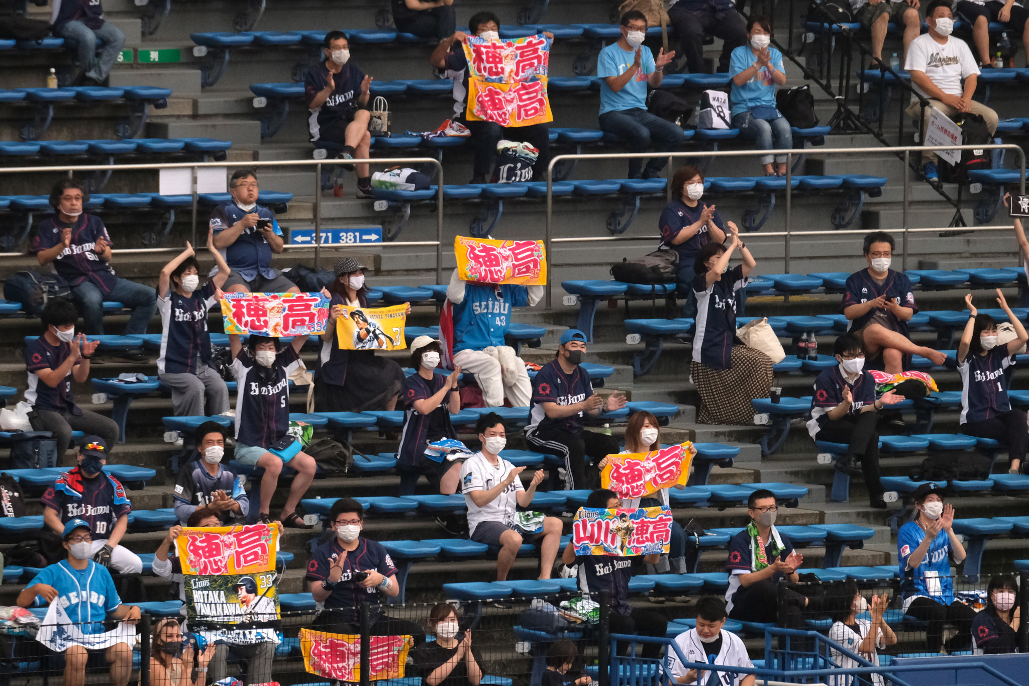 More than 10,000 spectators attend baseball and football matches as Japan eases capacity restrictions