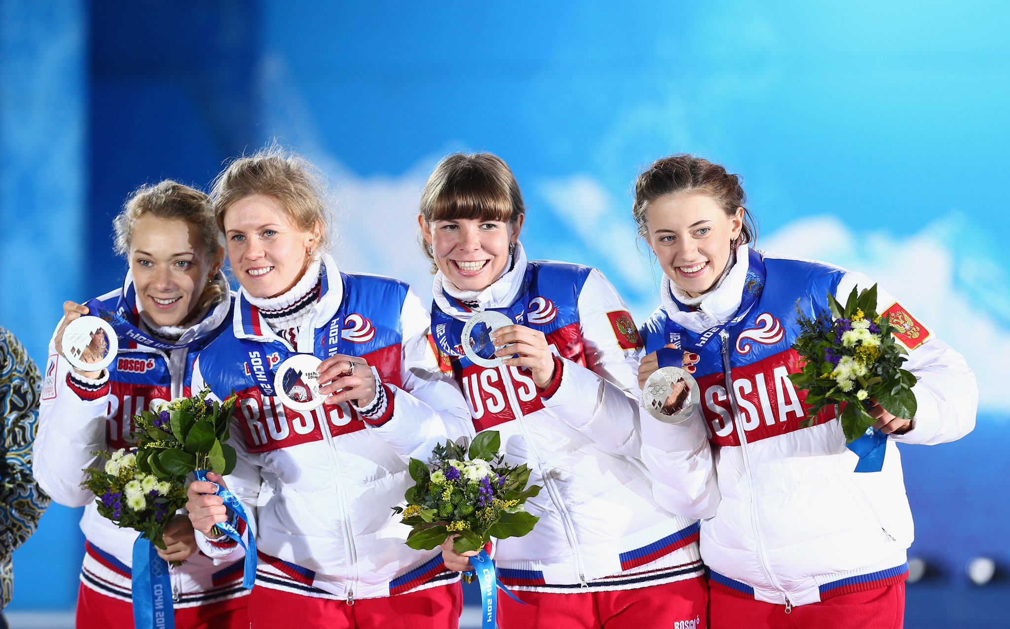 Olga Zaitseva, left, was convicted of a doping offence by Sochi 214 but her team-mates in the 4x6km relay at the 2014 Olympics in Sochi, Yana Romanova, second left, and Olga Vilukhina, right, were cleared ©Getty Images
