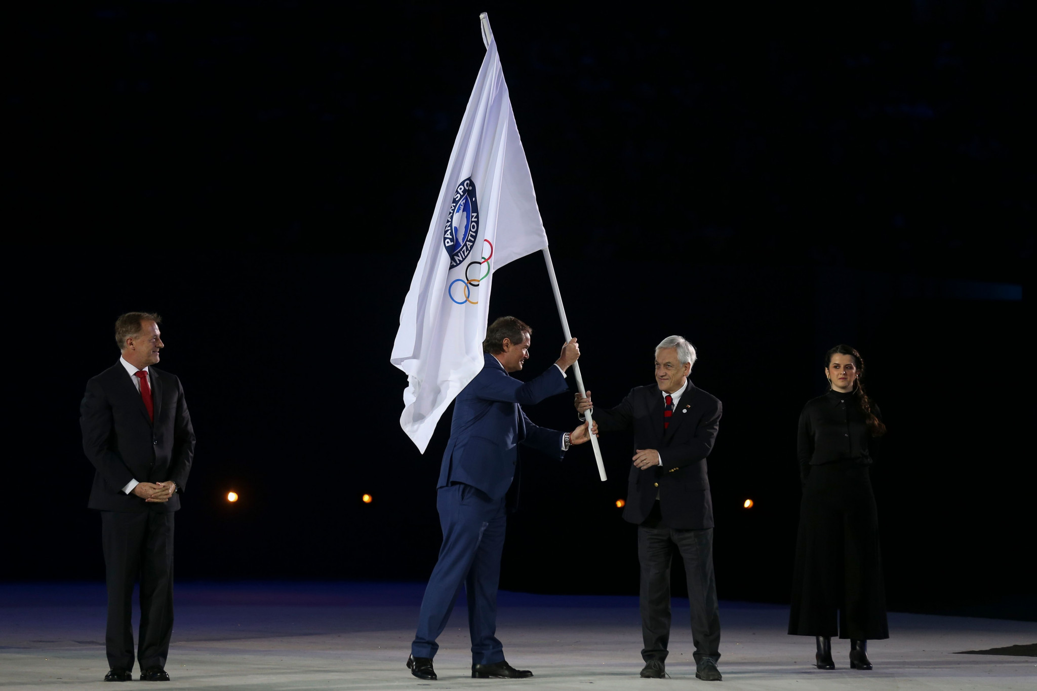 Neven Ilic, President of Panam Sports, hands the Pan-Am Games flag to Chilean President Sebastian Pinera in 2019 ©Getty Images