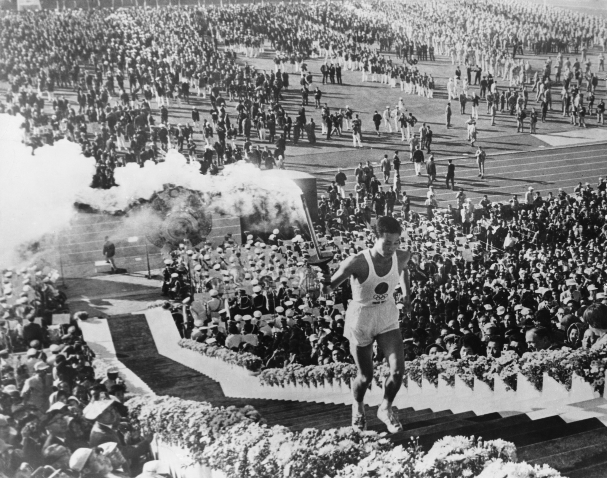 Yoshinori Sakai on his way to lighting the Cauldron to mark the start of the Tokyo 1964 Olympics ©Getty Images