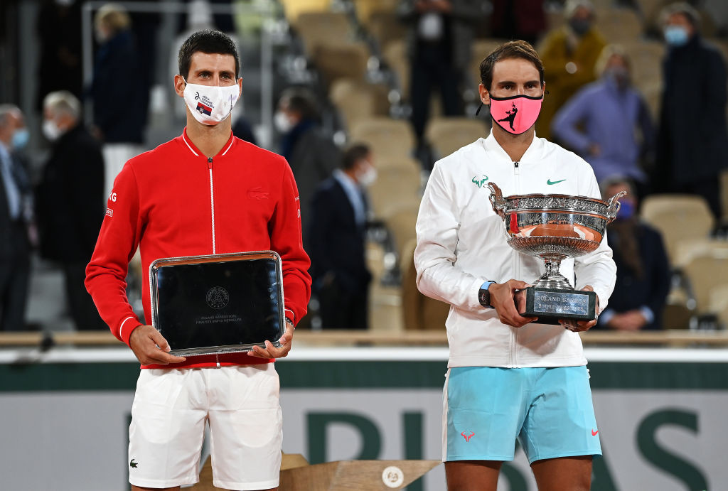 Serbia's Djokovic, left, poses with his runners-up prize alongside champion Nadal ©Getty Images