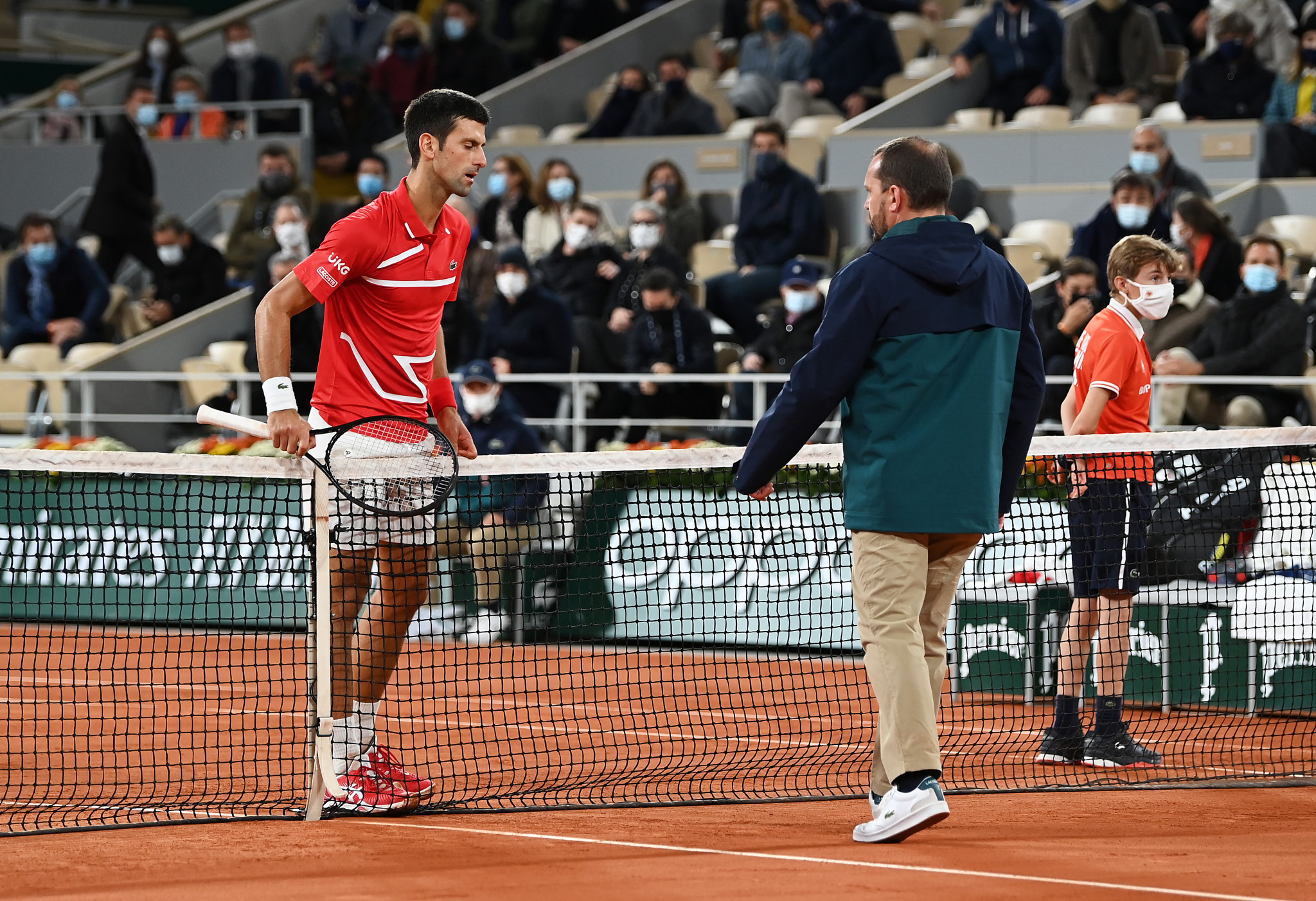 Serbia's Djokovic questions the umpire's call to overturn the line judge's decision and give Nadal a chance to serve for the title ©Getty Images