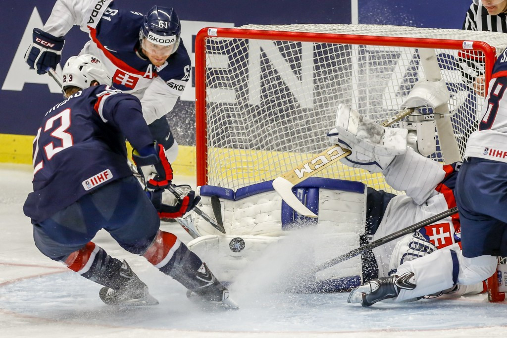 The United States topped Group B after they beat Slovakia 5-4 in overtime