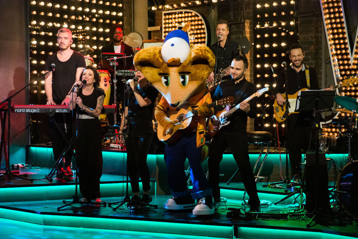 Yekaterinburg 2023 mascot Cedry performs with the band Fruits as part of his unveiling on Russian television ©FISU