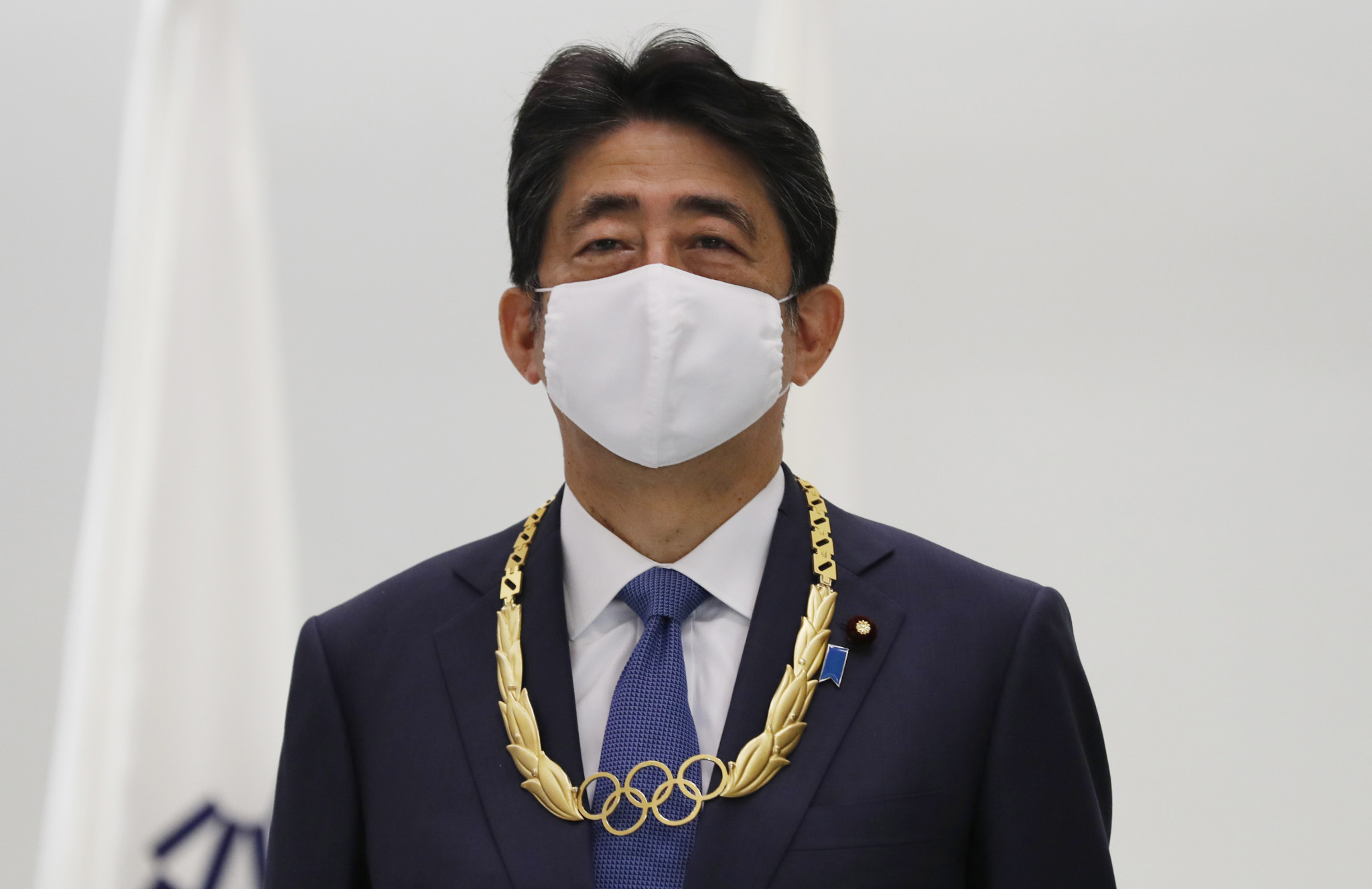 Former Japanese Prime Minister Abe presented with gold Olympic Order