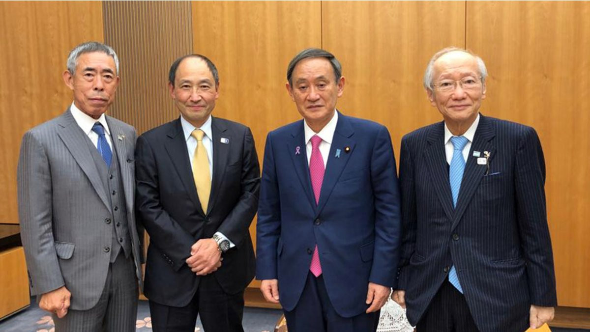 Toshihisa Nagura was joined by two Japanese karate executives at his meeting with Prime Minister Yoshihide Suga ©WKF