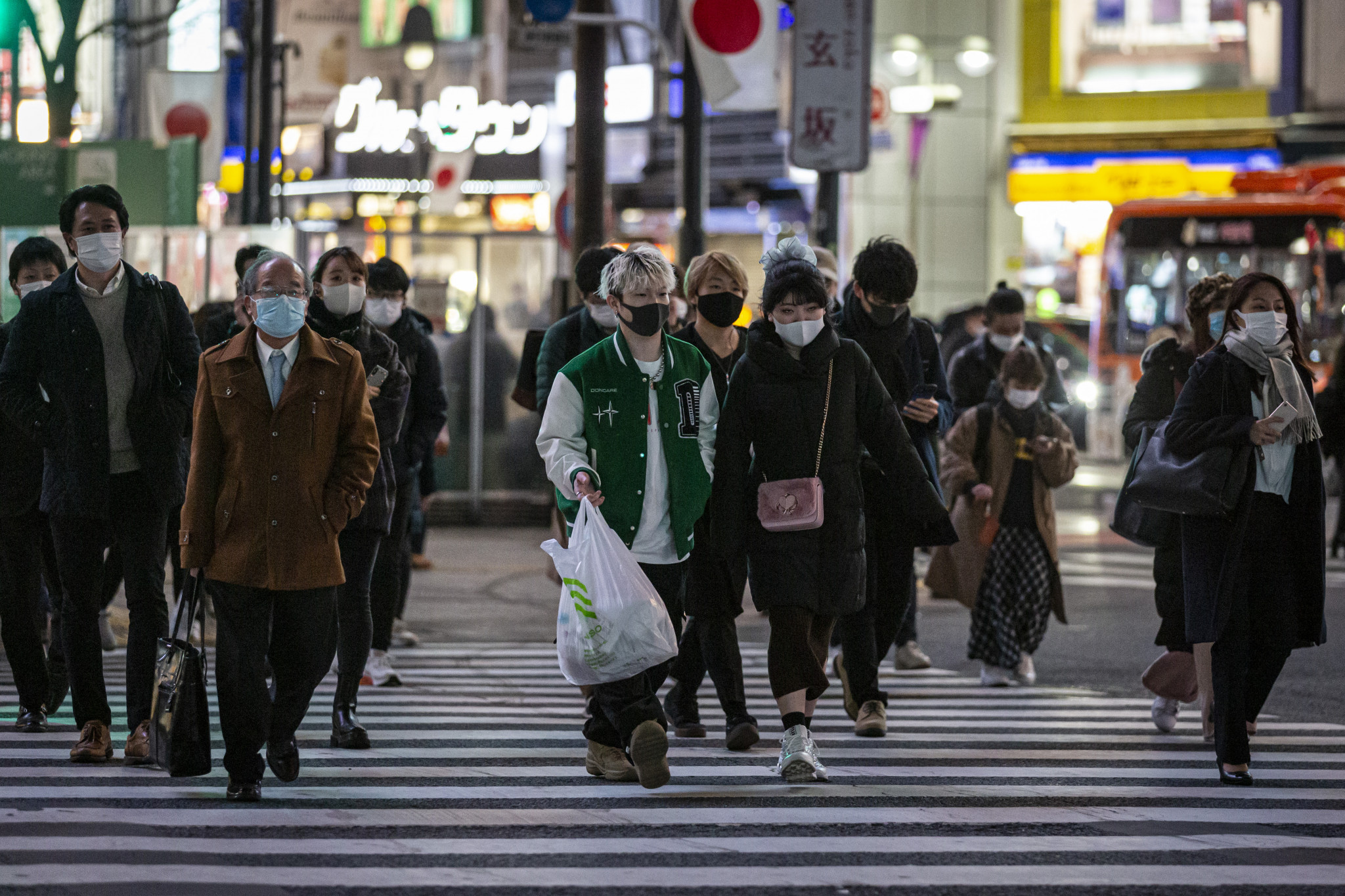 Japan reports record daily coronavirus cases as Government prepares to announce restrictions