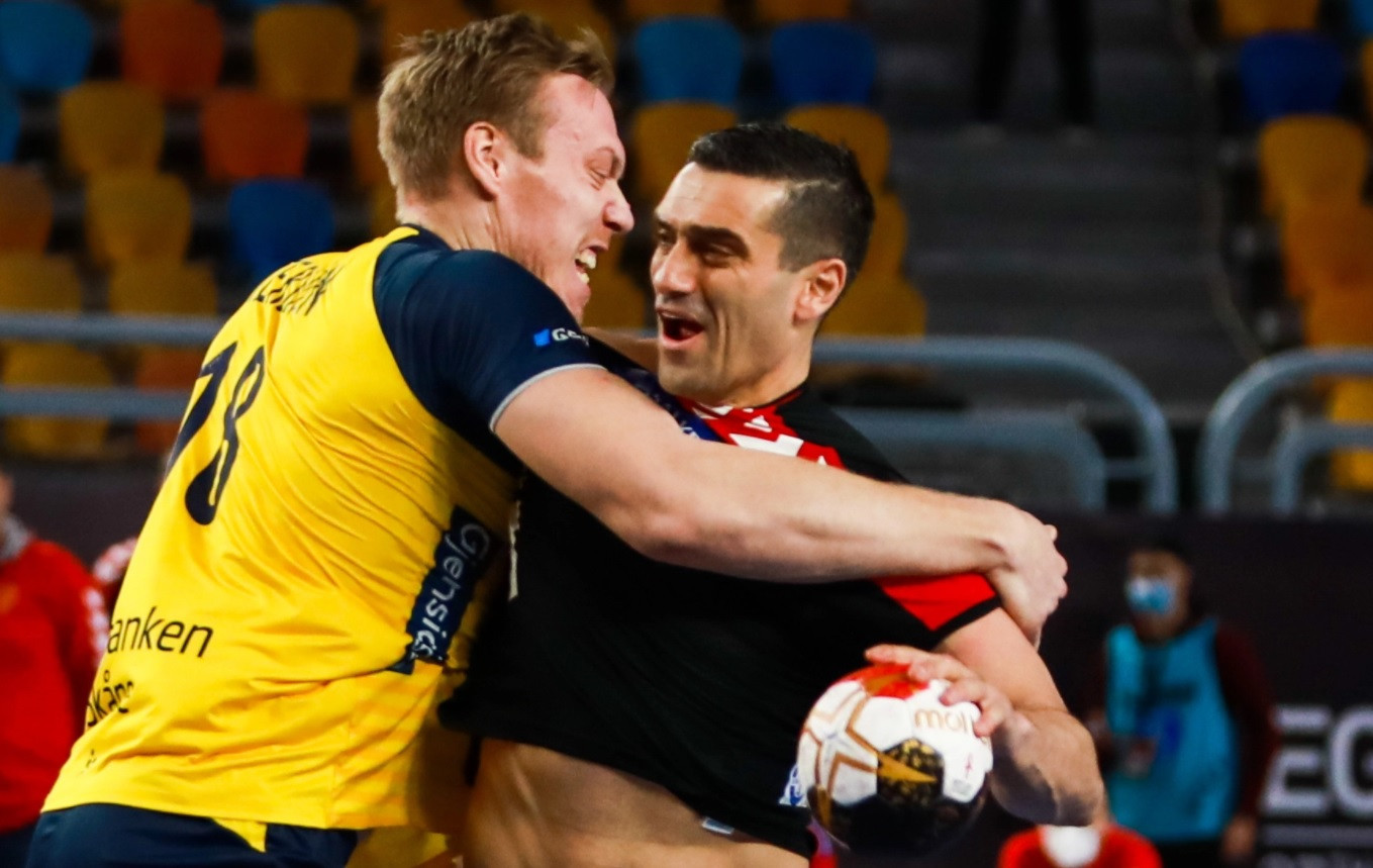 Sweden (yellow shirts) defeated North Macedonia in one of eight group games on day two of the IHF Men's World Championships in Egypt ©Handball Egypt