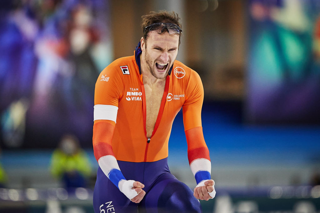 Thomas Krol celebrates leading home a Netherlands medal sweep in the men's 1,500m at the Thialf Arena ©ISU
