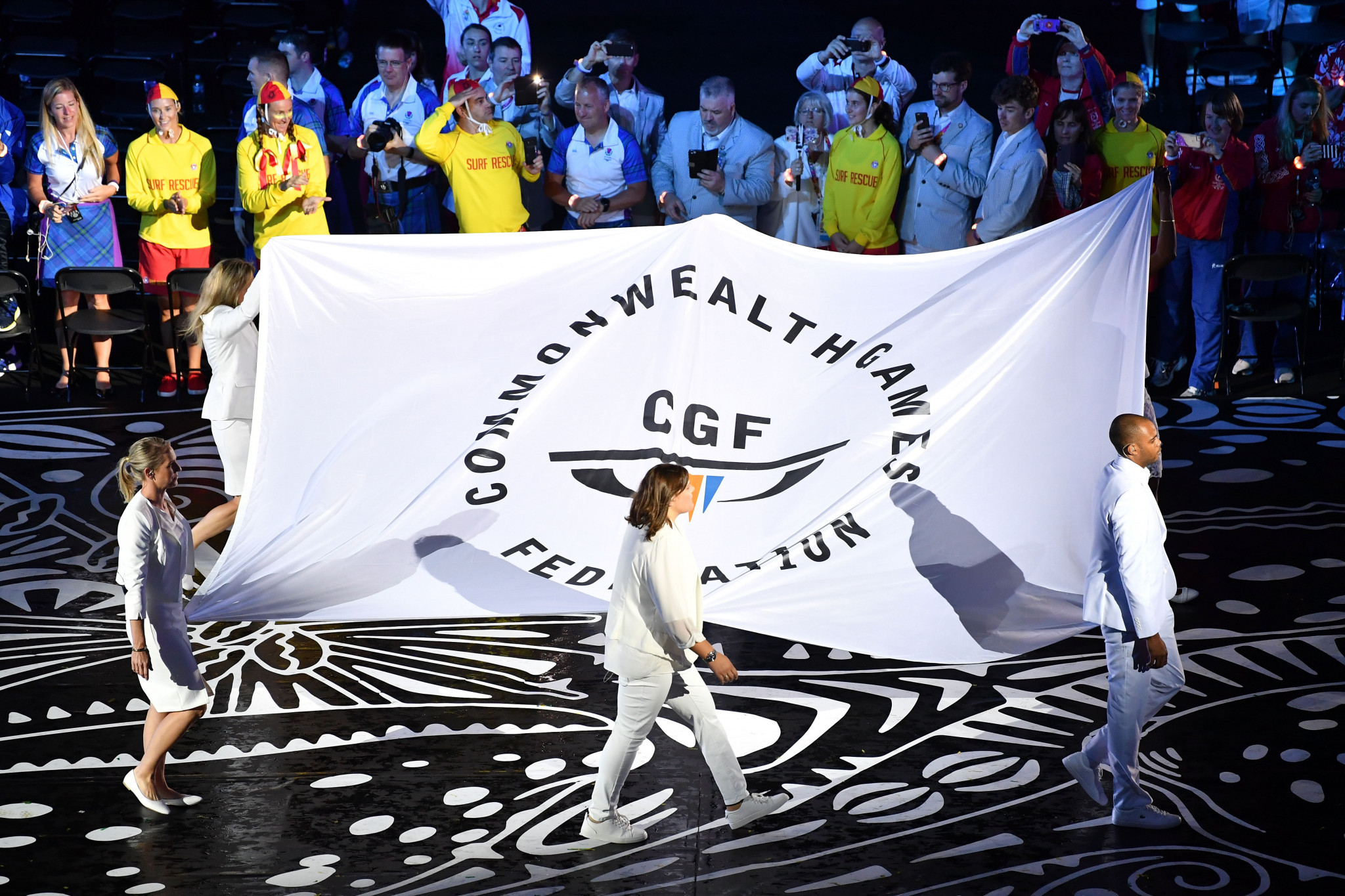 The Commonwealth Games Federation flag is carried into the stadium by Brendan Williams, Natalie Du Toit, Alison Shanks, Nicole Forrester, Colin Gregor and Rhona Toft during the Opening Ceremony for Gold Coast 2018 ©Getty Images