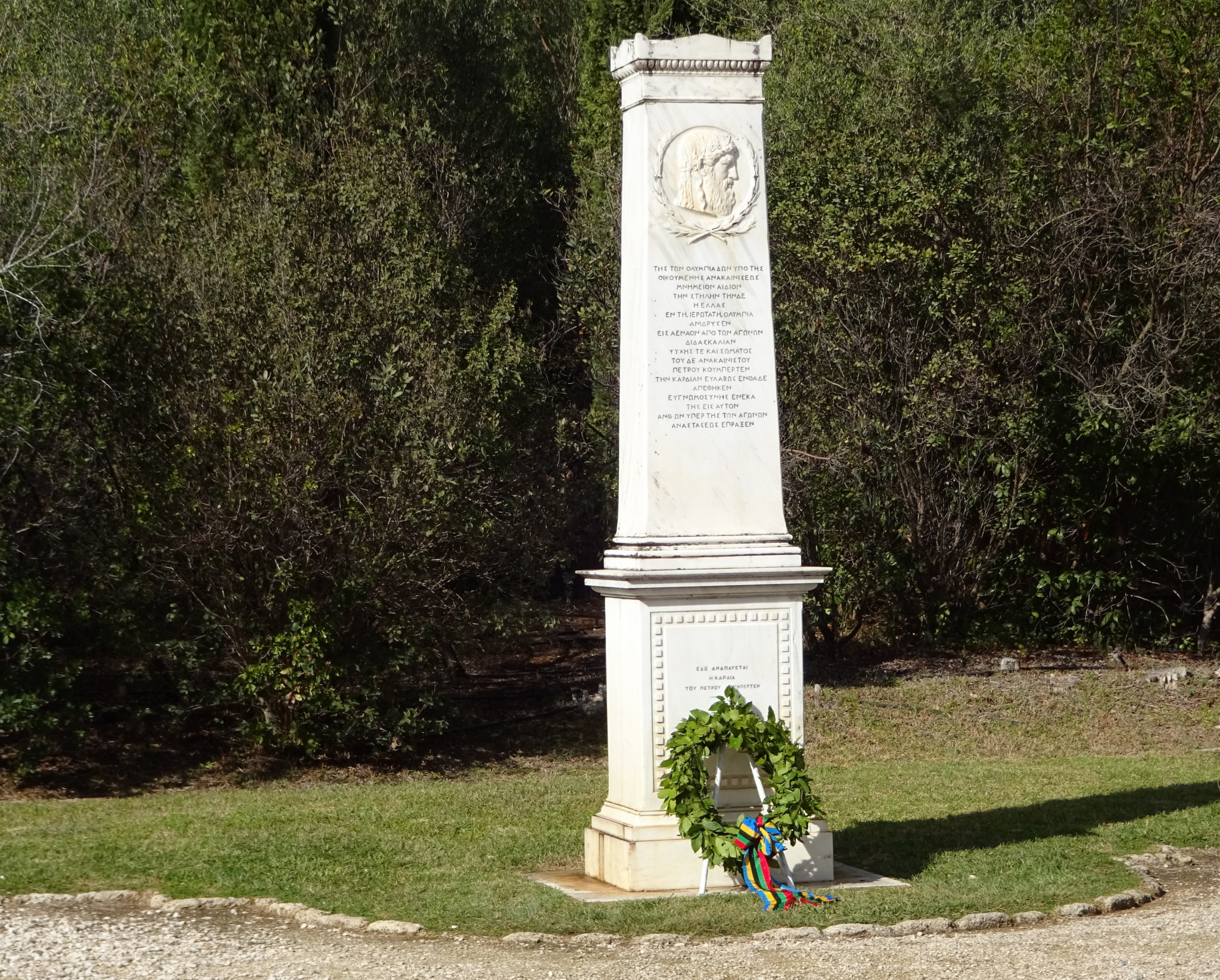 A wreath is laid at the Coubertin monument when the IOC visits Olympia ©Philip Barker