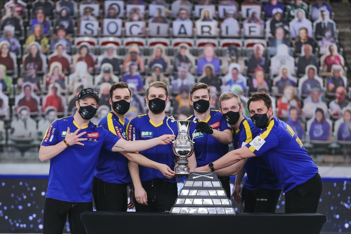 Sweden's team celebrate winning a third successive World Men's Curling Championship title ©WCF/Jeffrey Au