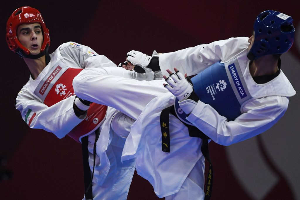Mirhashem Hosseini, left, already has a world silver and an Asian Games gold in his collection ©Getty Images