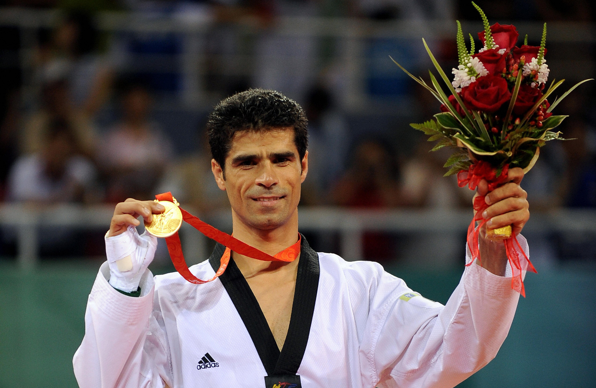 Iran's most decorated Olympian Saei steps down as taekwondo technical director