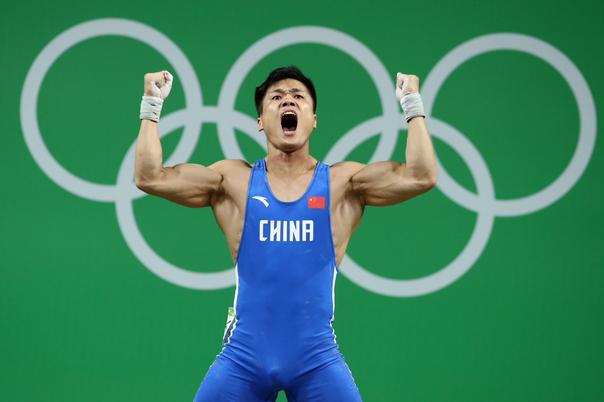 Lju Xiaojun celebrated another gold medal and world record at the Asian Weightlifting Championships ©Getty Images